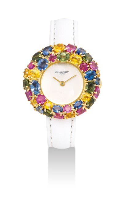 CHAUMET. A LADY'S 18K GOLD AND