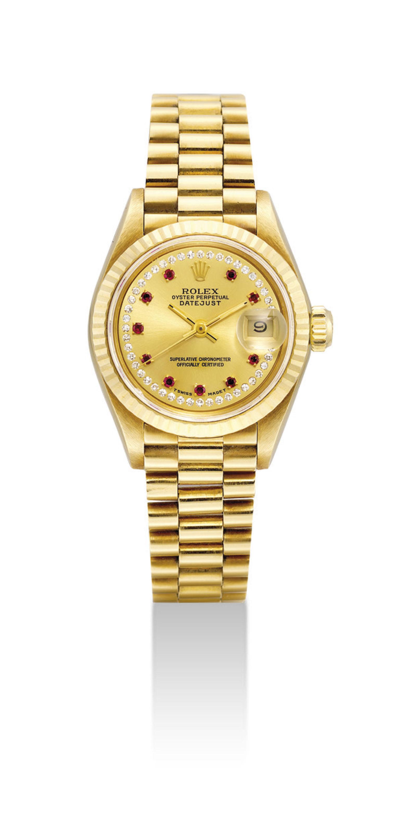 ROLEX. A LADY'S 18K GOLD, DIAM
