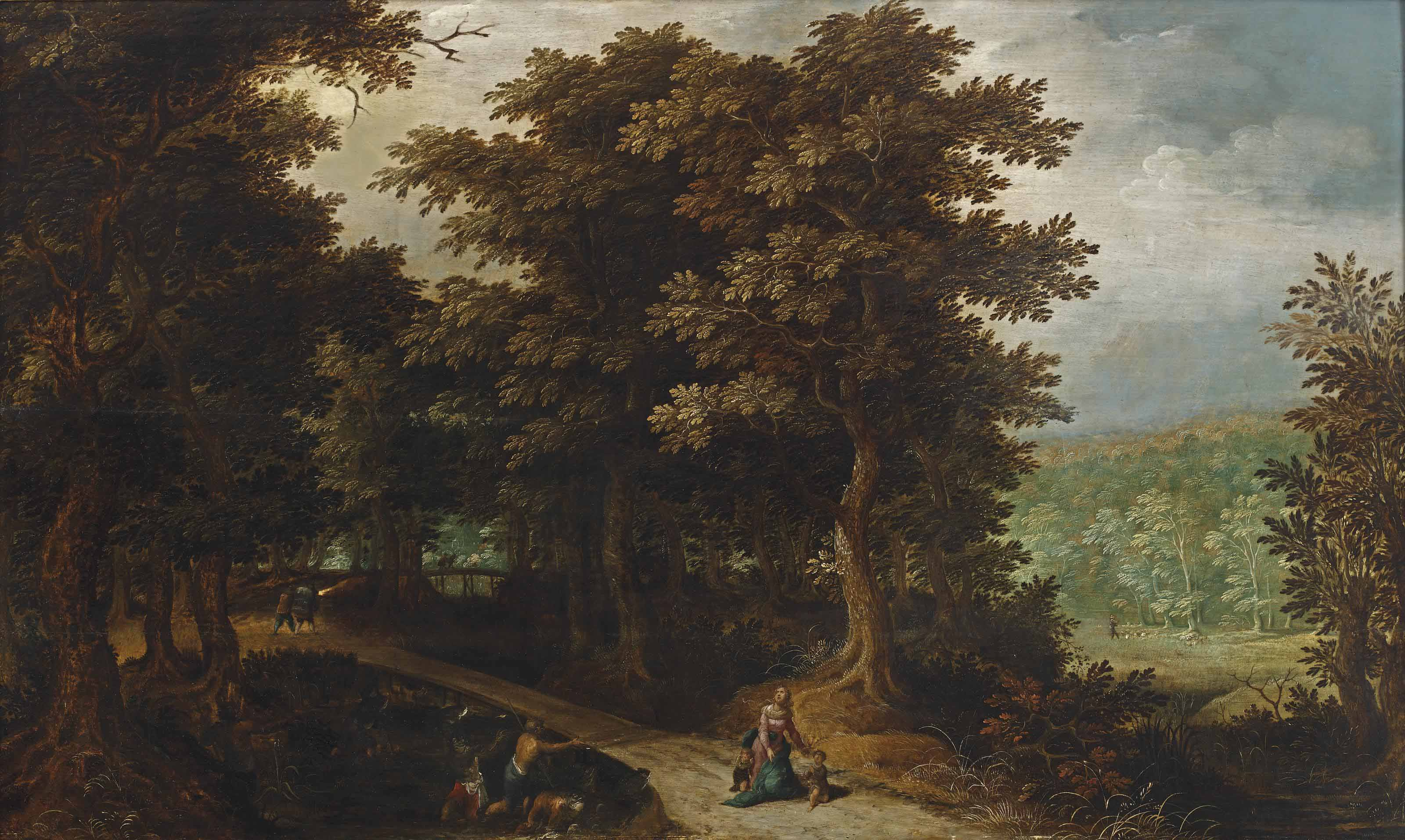 A wooded landscape with Latona turning the peasants into frogs