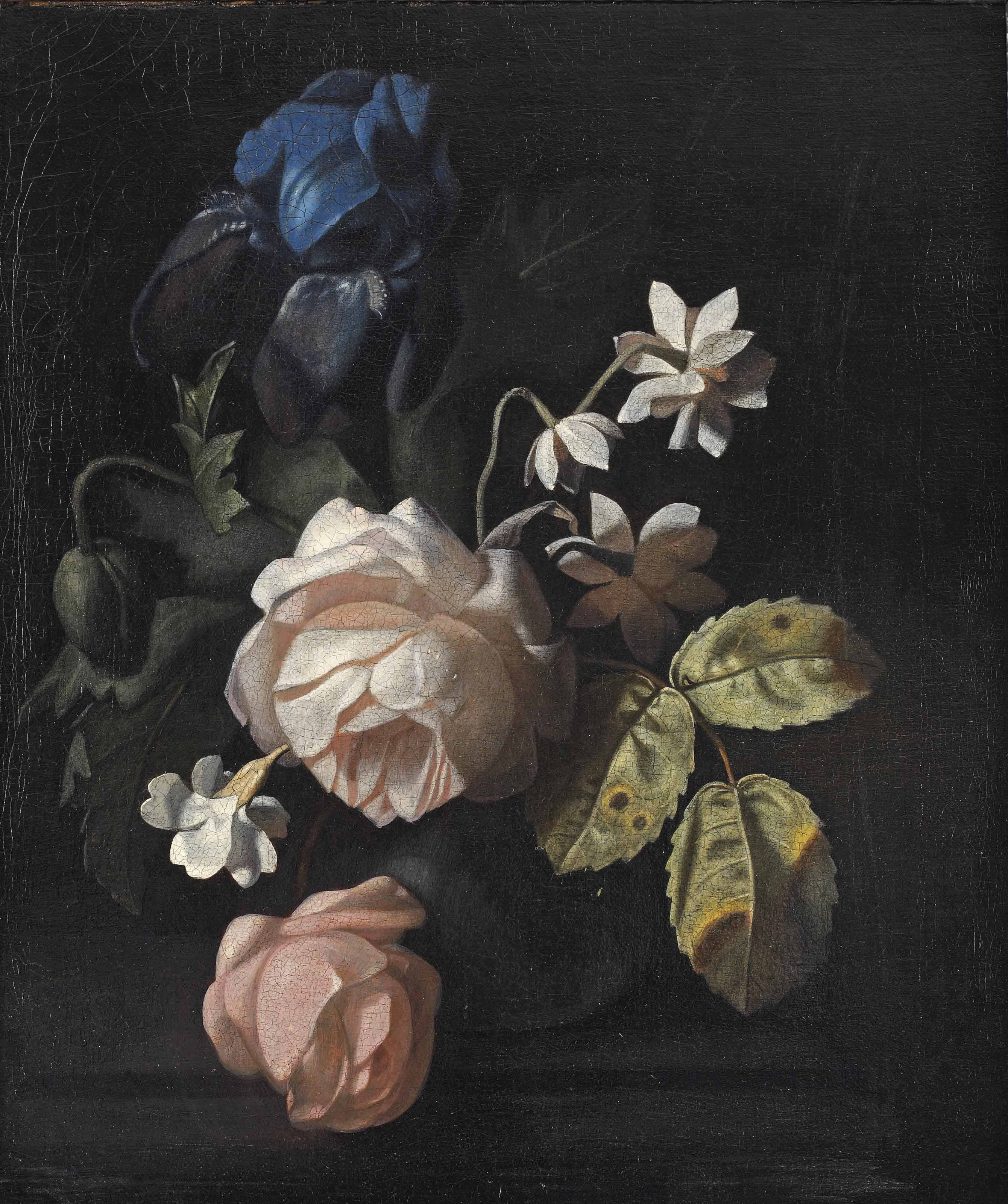 Roses, an iris and other flowers in a vase on a ledge