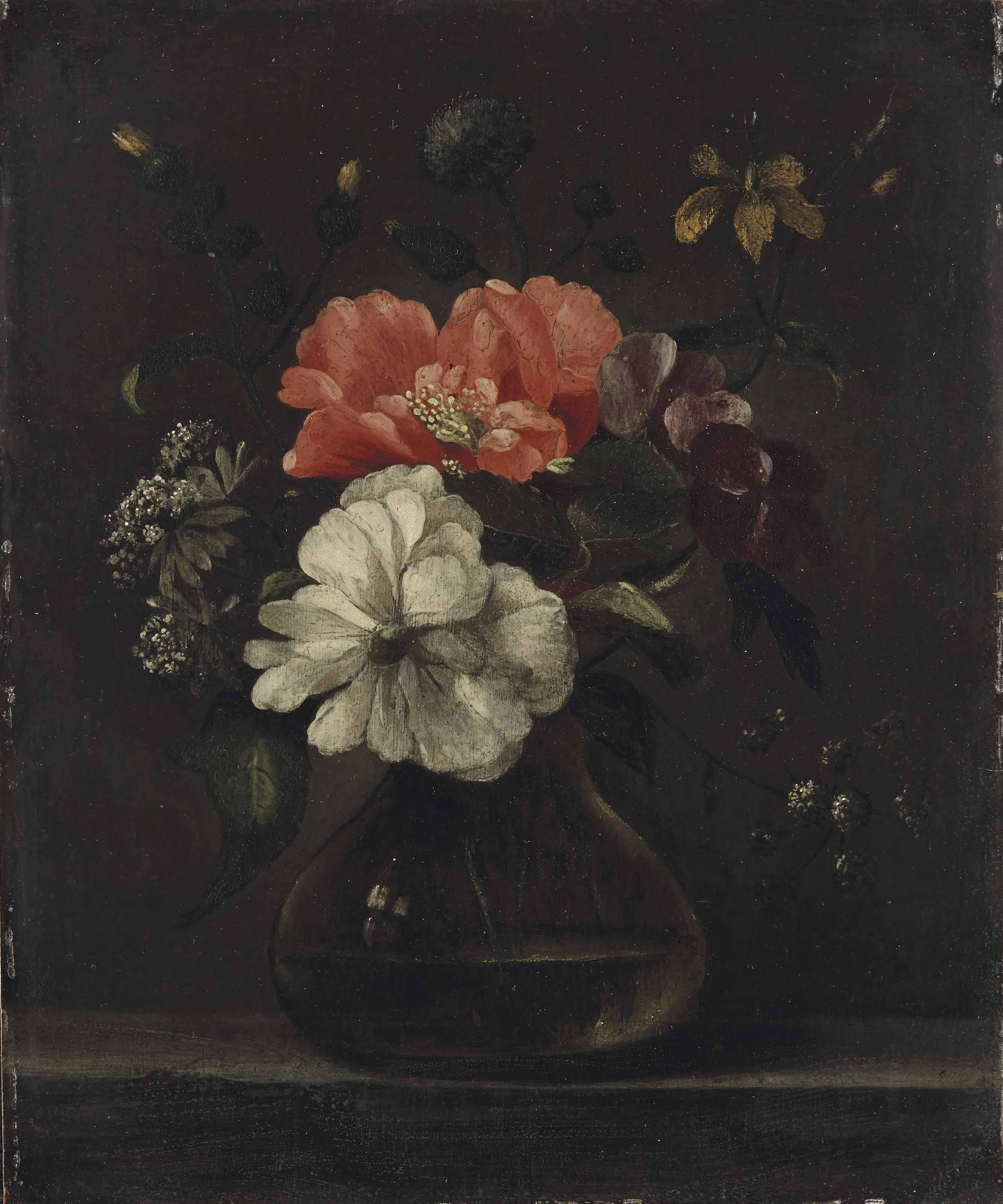 Flowers in a glass vase on a stone ledge