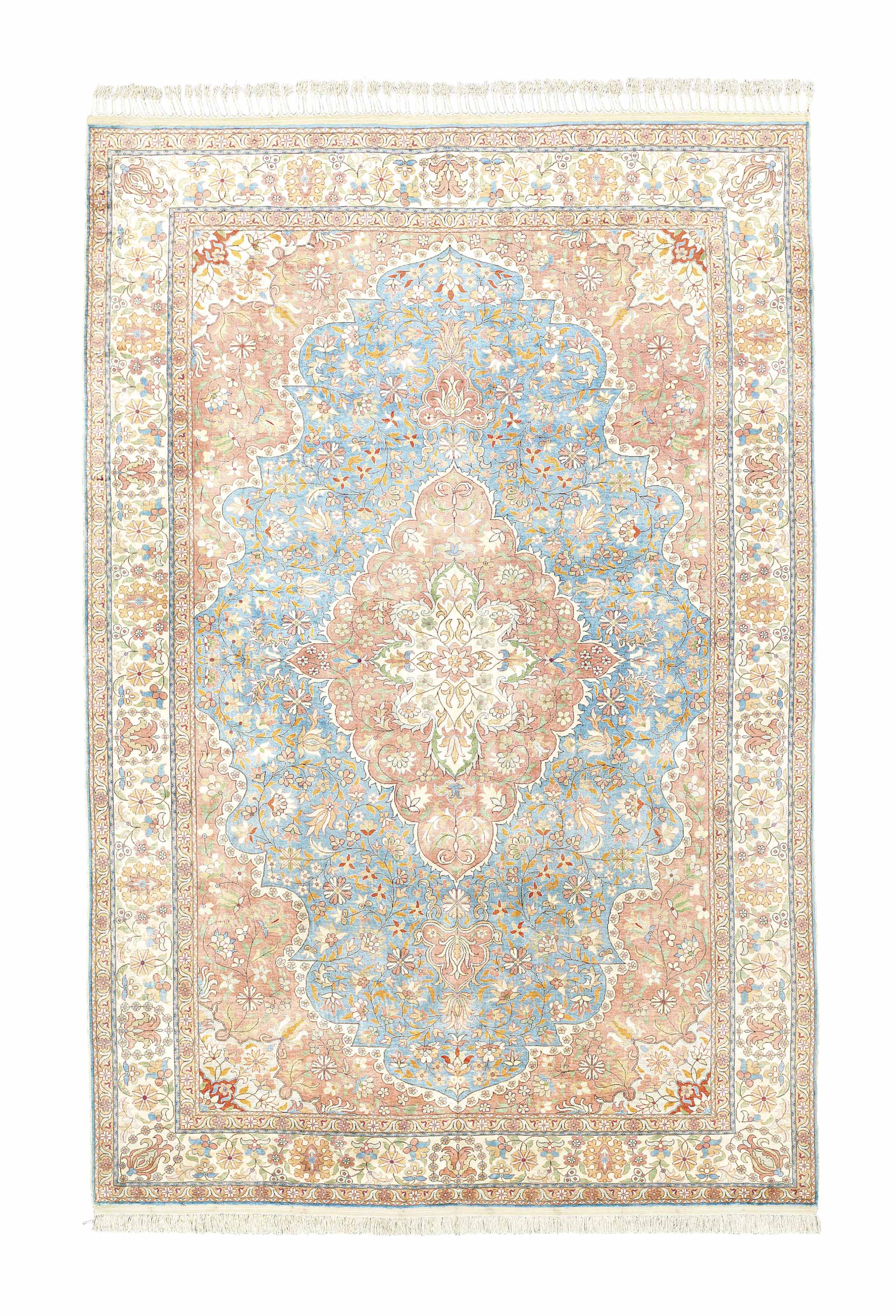 A SILK HEREKE CARPET