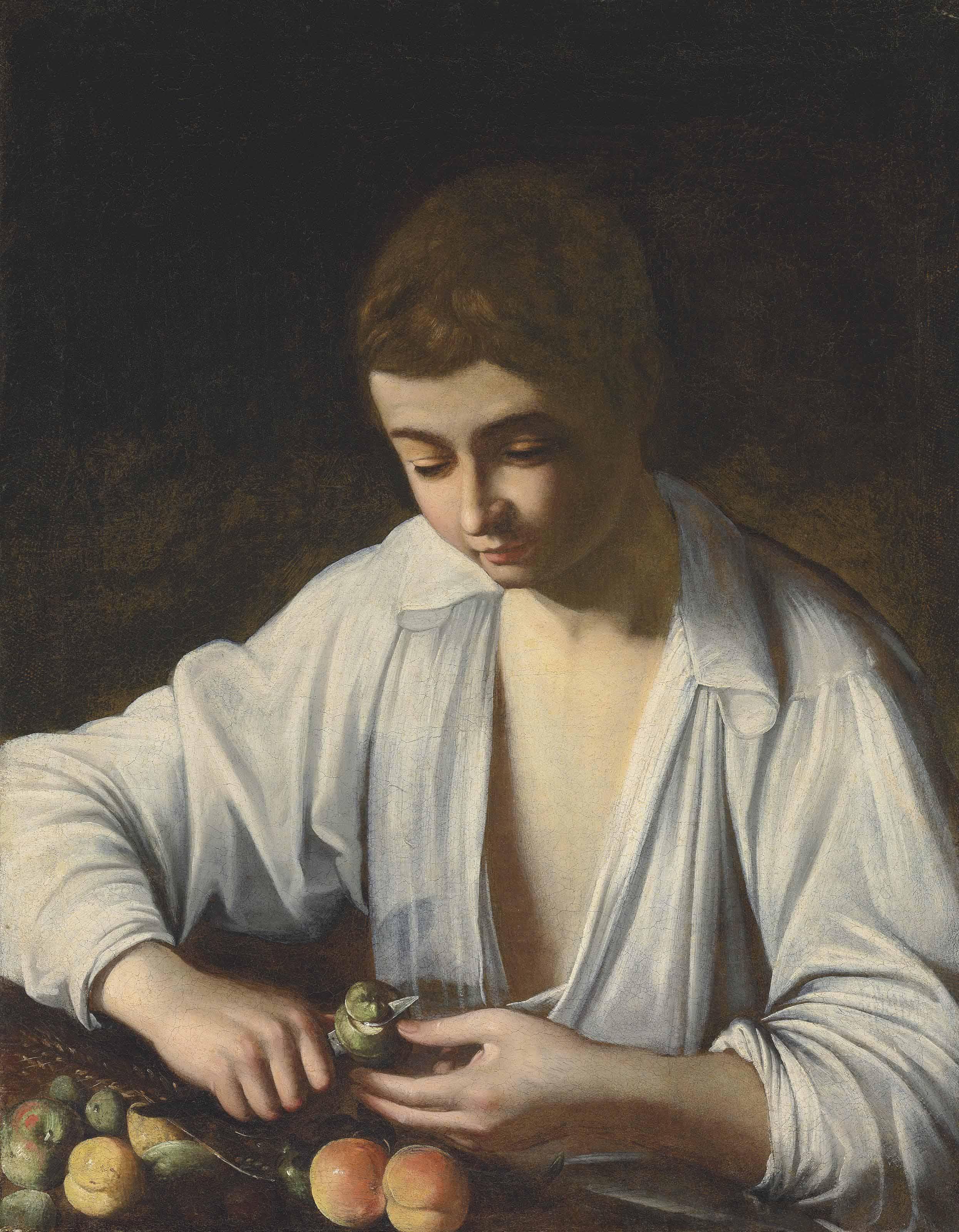 A boy peeling fruit