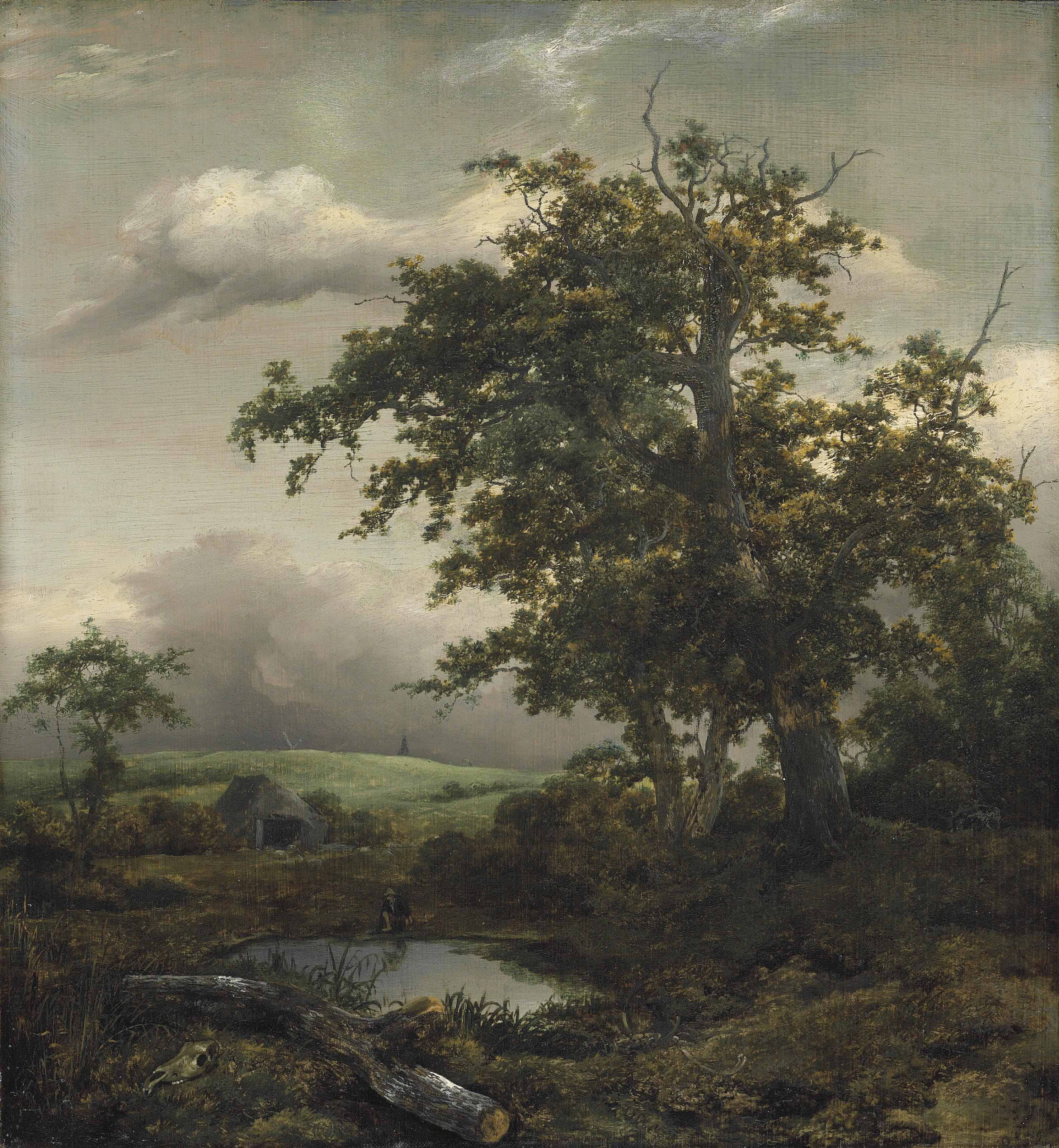 A wooded landscape with a man at rest by a pond near a hut, a windmill beyond