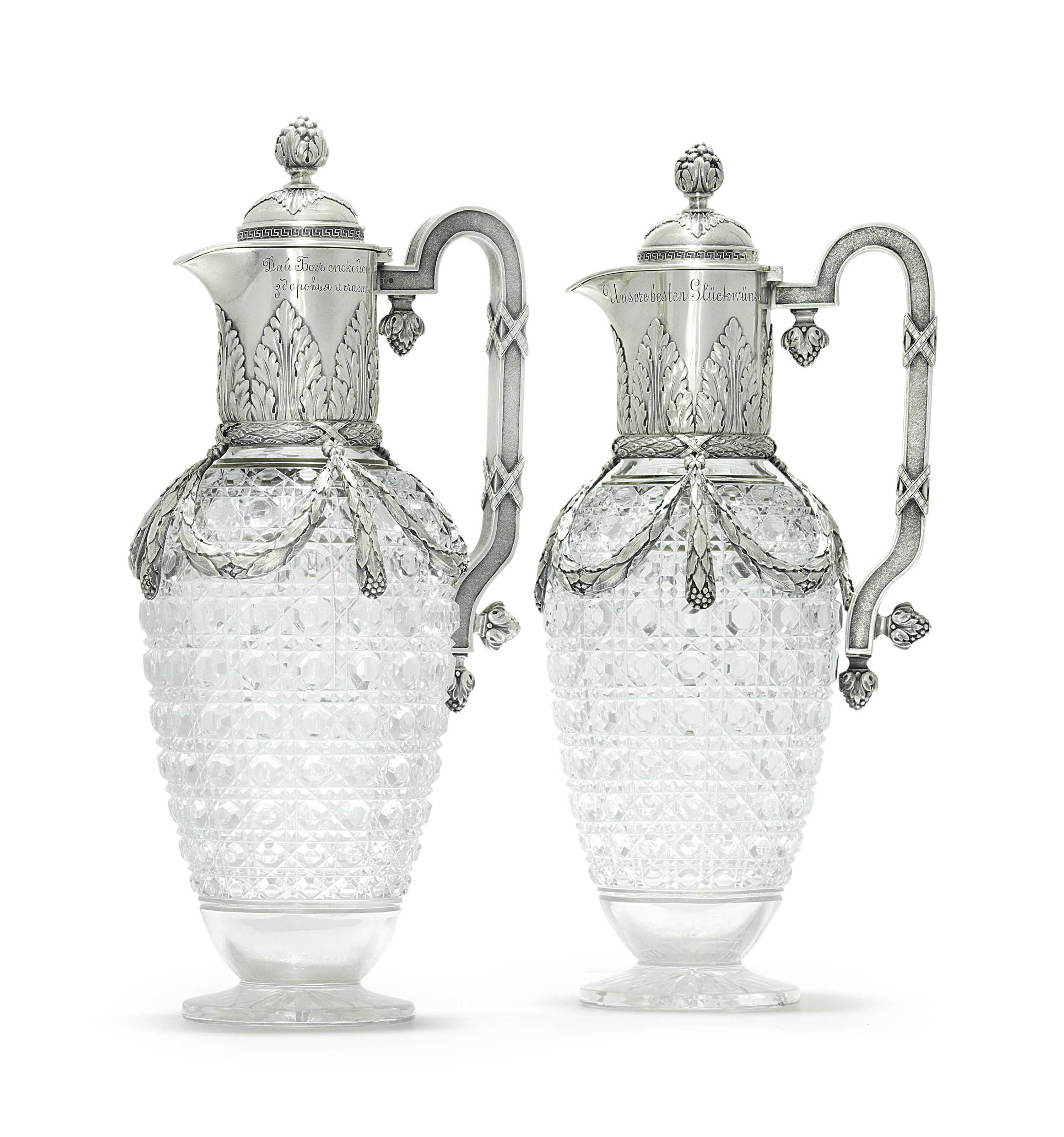 A PAIR OF SILVER-MOUNTED CUT-GLASS DECANTERS