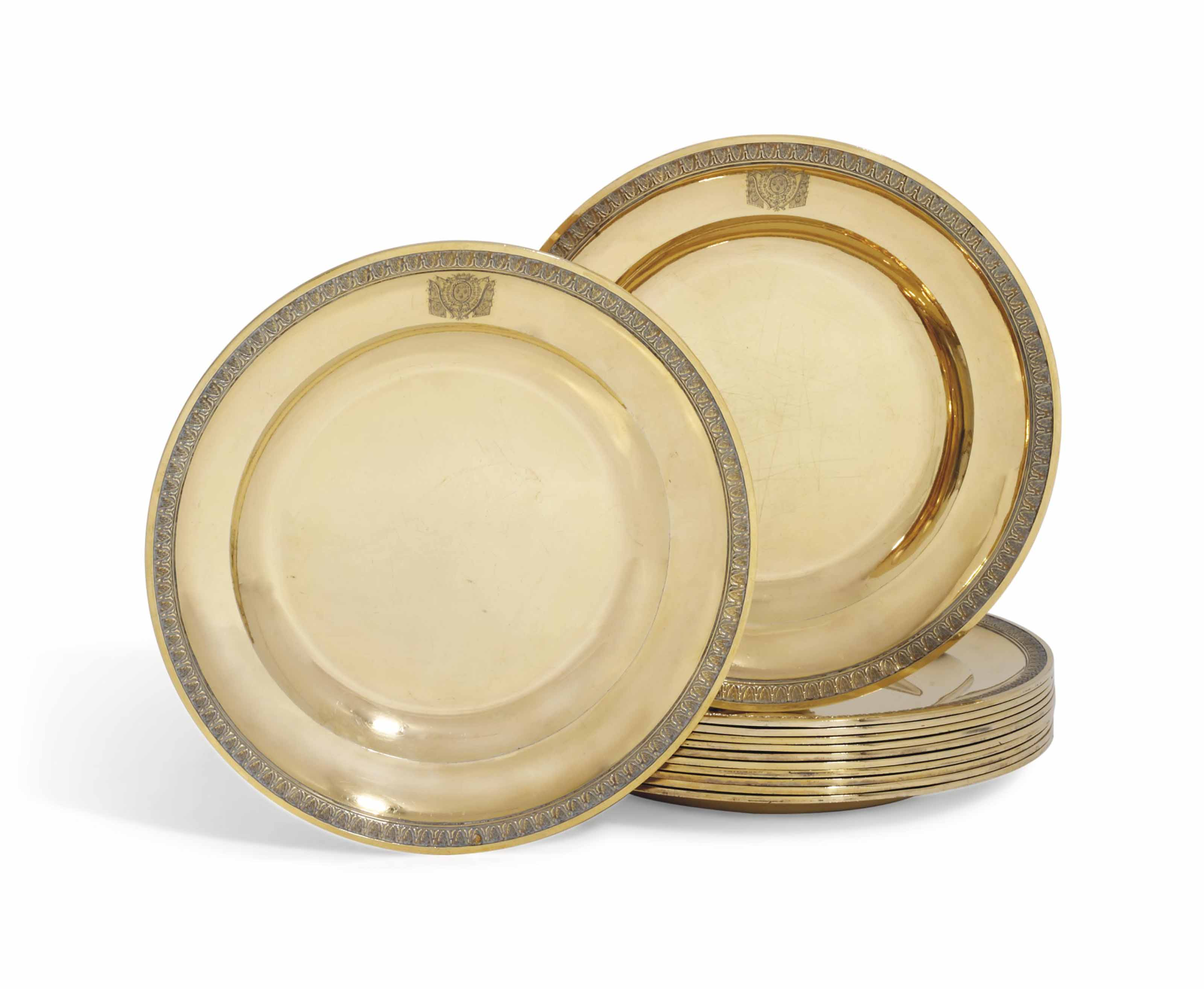 A SET OF TWELVE FRENCH SILVER-GILT DESSERT-PLATES