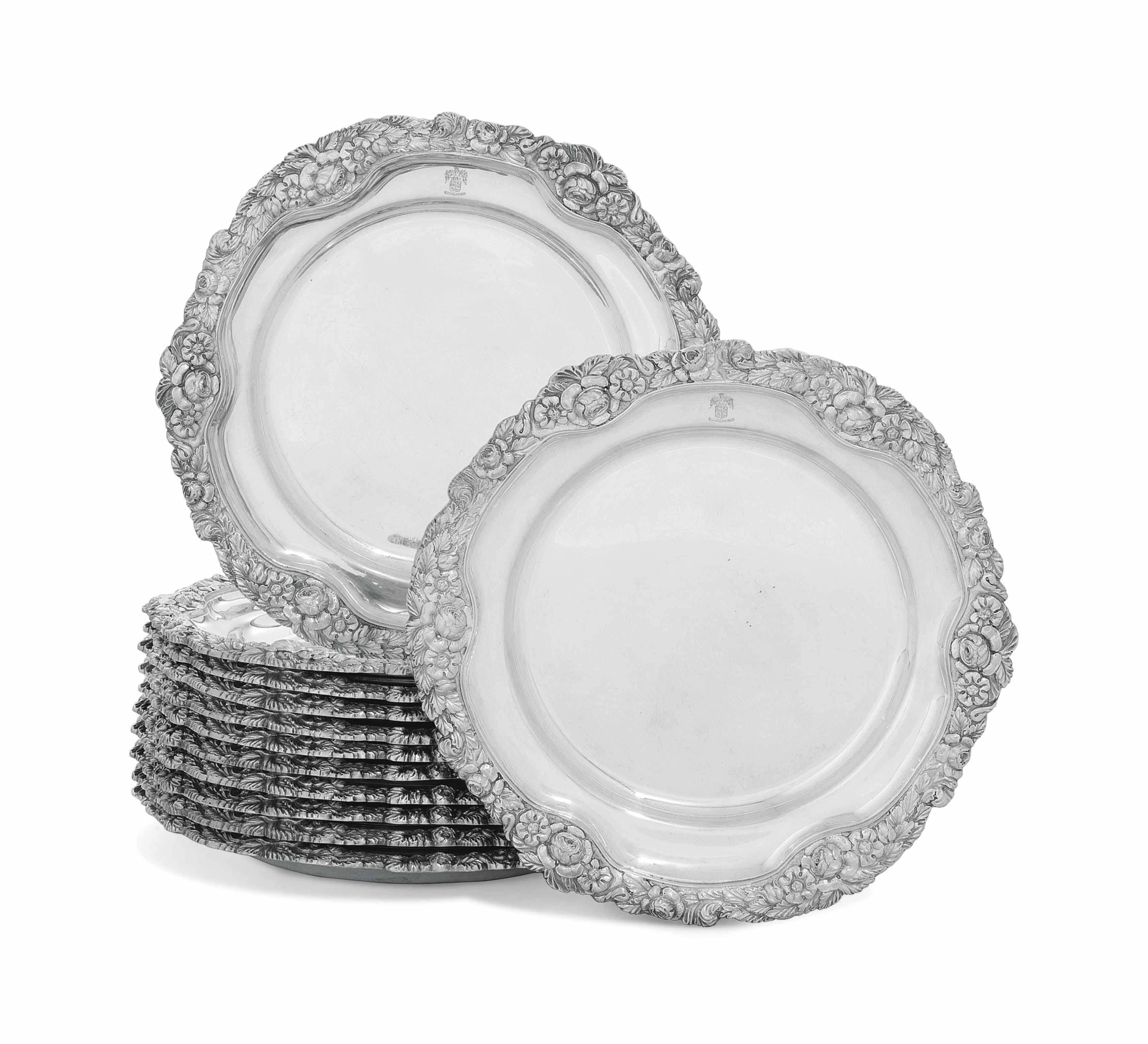 A SET OF TWELVE IRISH SILVER DINNER-PLATES