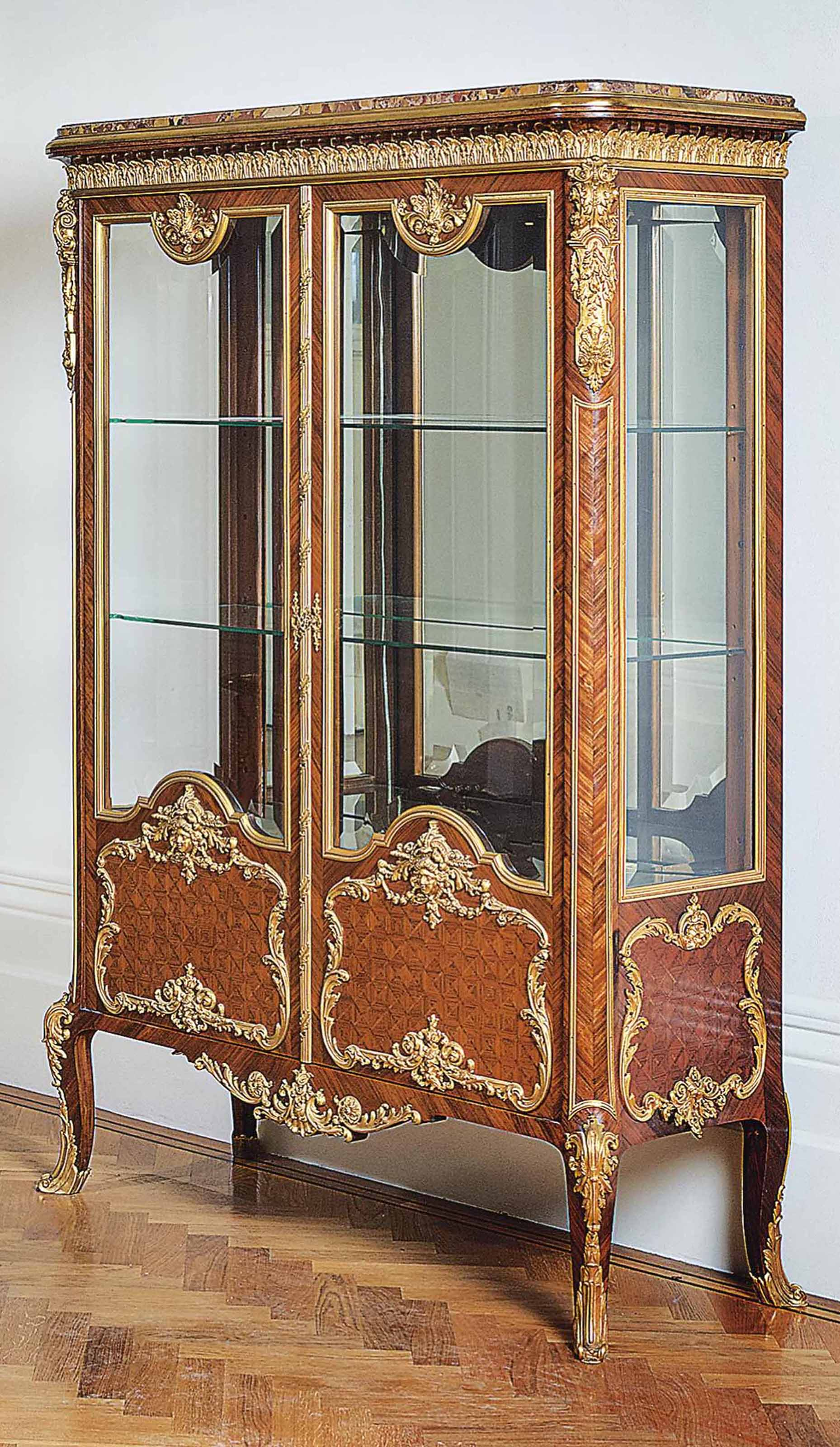A FRENCH ORMOLU-MOUNTED KINGWOOD, BOIS SATINE AND PARQUETRY VITRINE CABINET