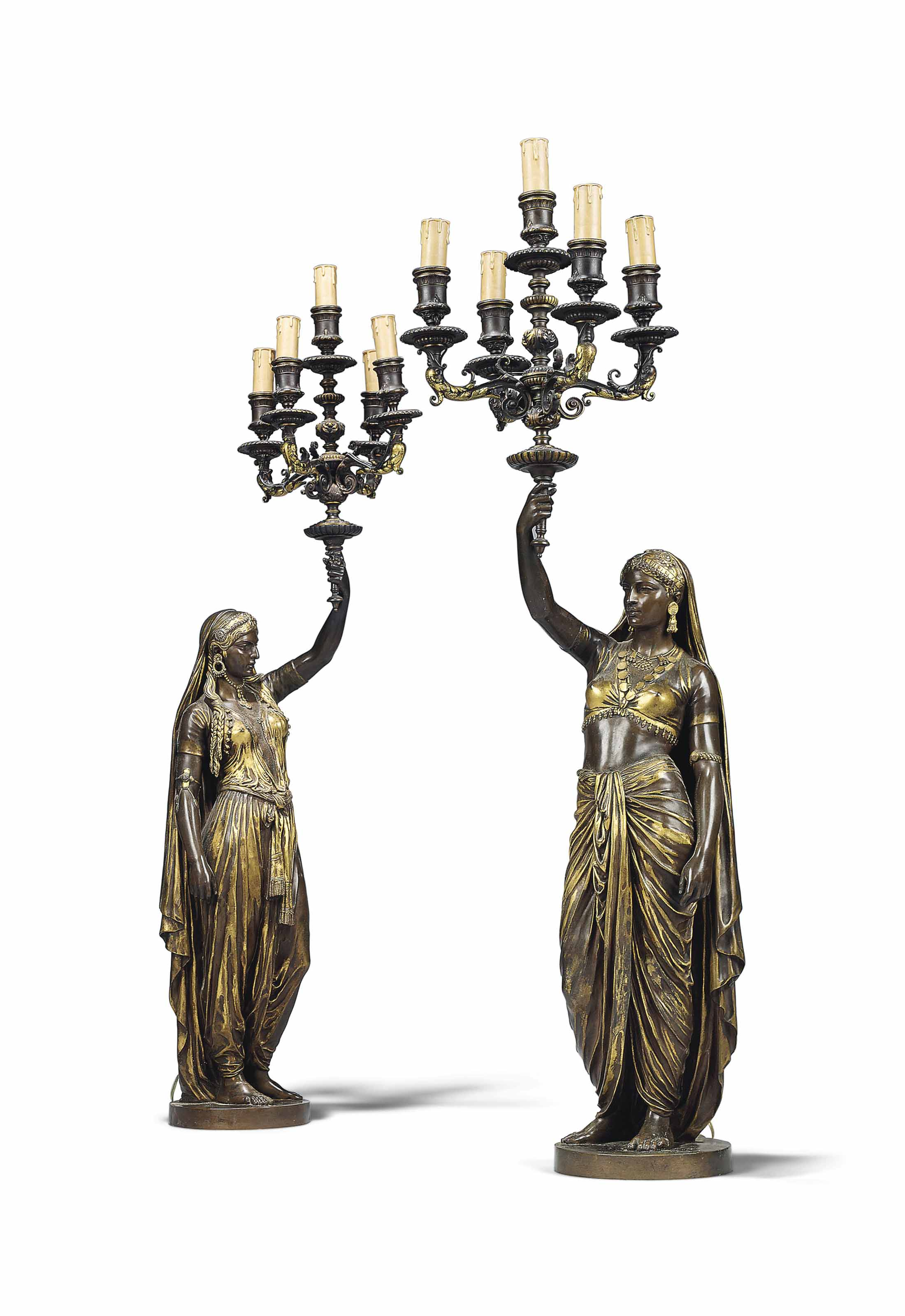 A PAIR OF FRENCH PARCEL-GILT AND PATINATED BRONZE FIGURAL FIVE-LIGHT TORCHERES