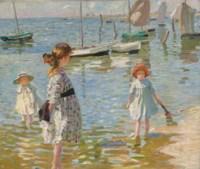 Children paddling on the sea shore