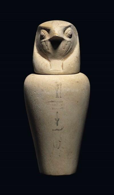 AN EGYPTIAN LIMESTONE CANOPIC