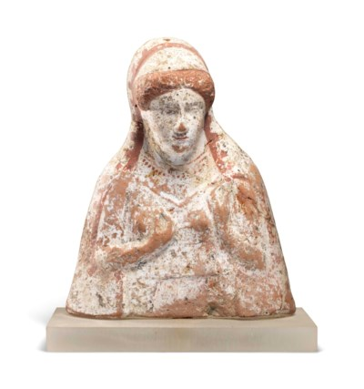 A GREEK TERRACOTTA FEMALE PROT