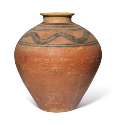 AN IRANIAN POTTERY JAR