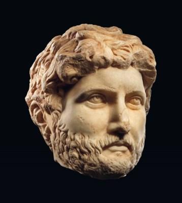 A MONUMENTAL ROMAN MARBLE HEAD