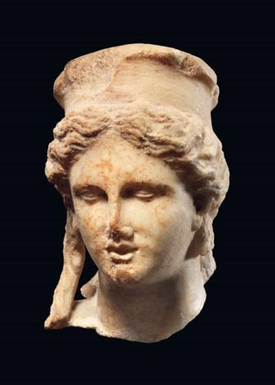 A ROMAN MARBLE HEAD OF CYBELE