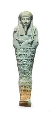 AN EGYPTIAN PALE GREEN FAIENCE