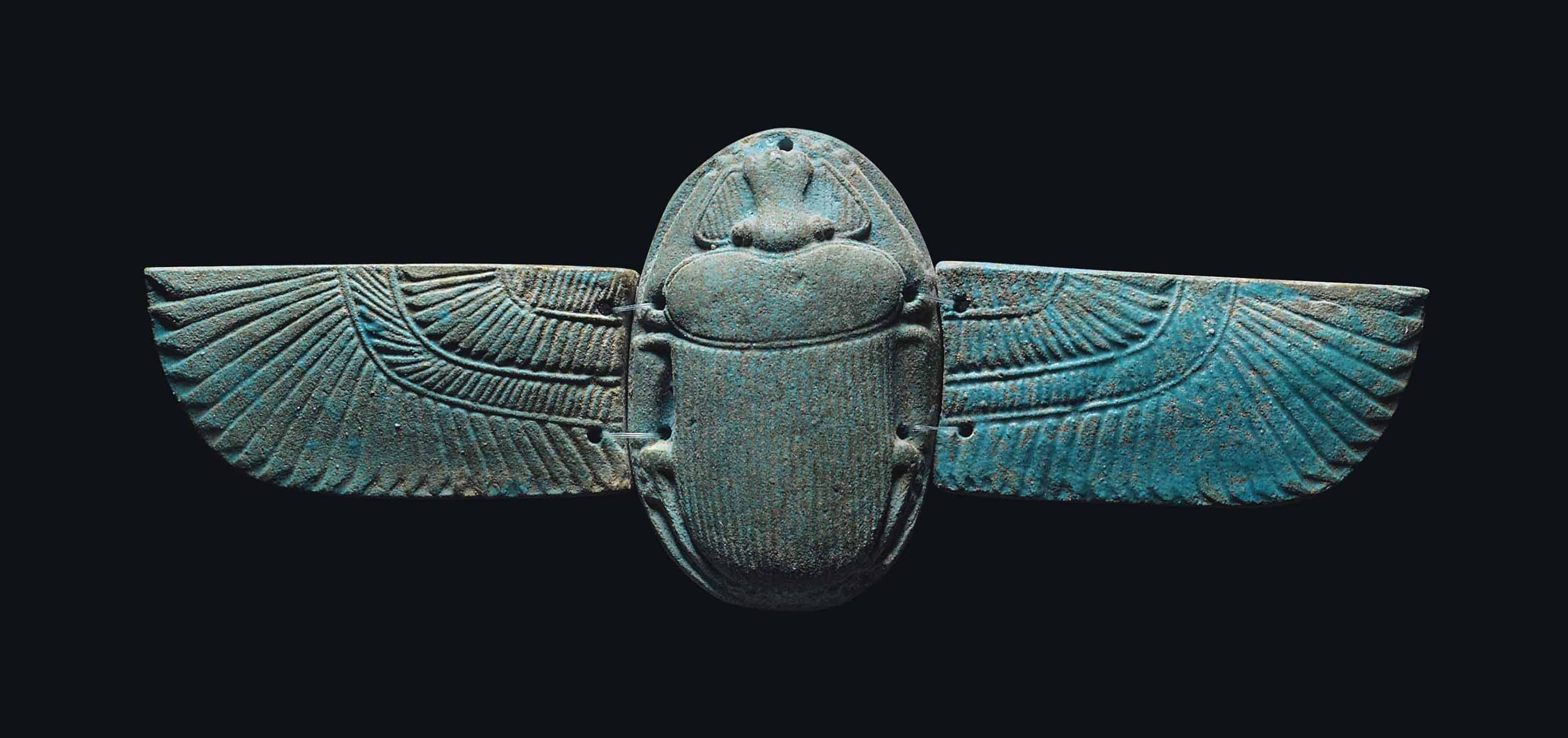 AN EGYPTIAN BLUE FAIENCE WINGE