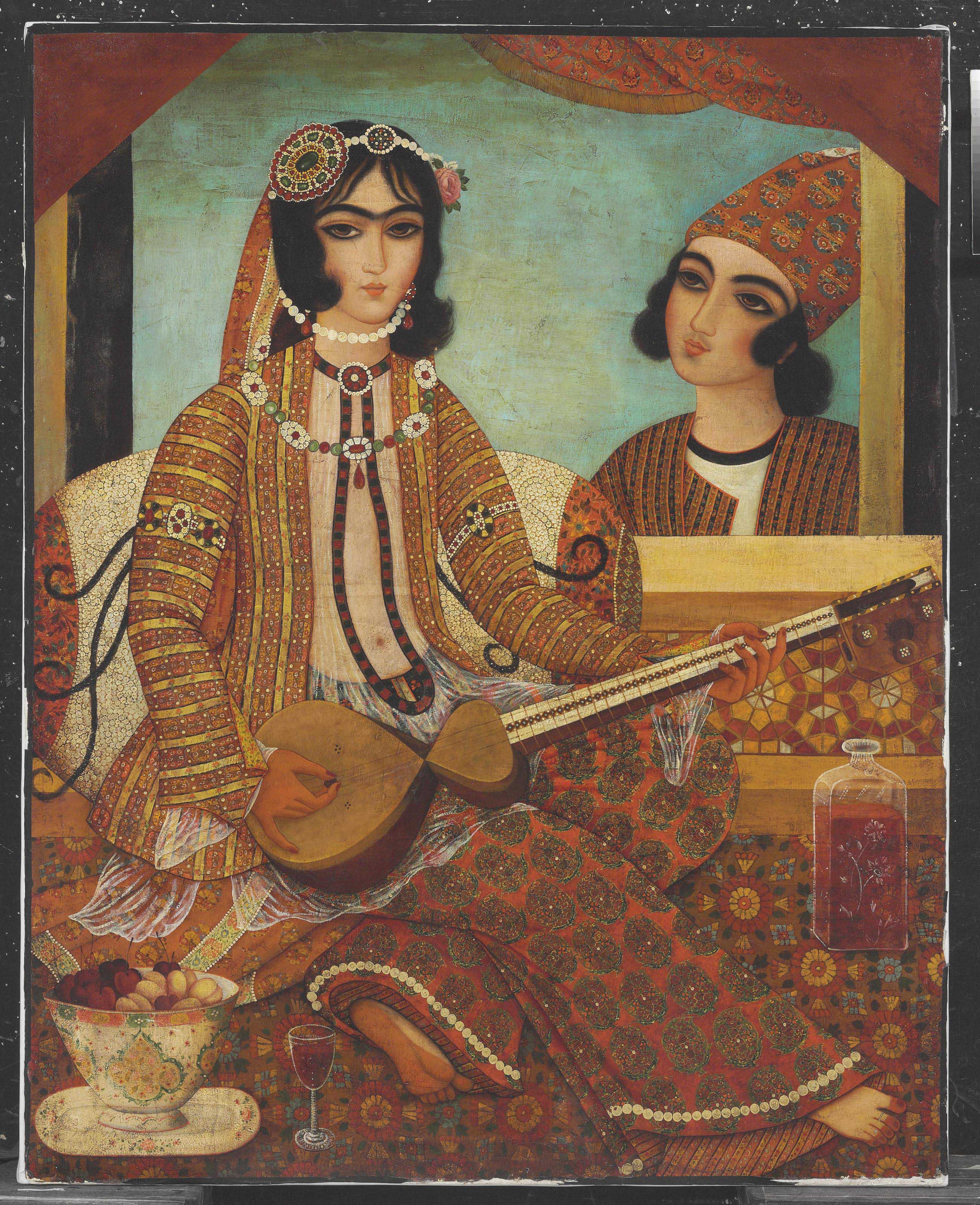 A LADY PLAYING A STRINGED INSTRUMENT | QAJAR IRAN, EARLY