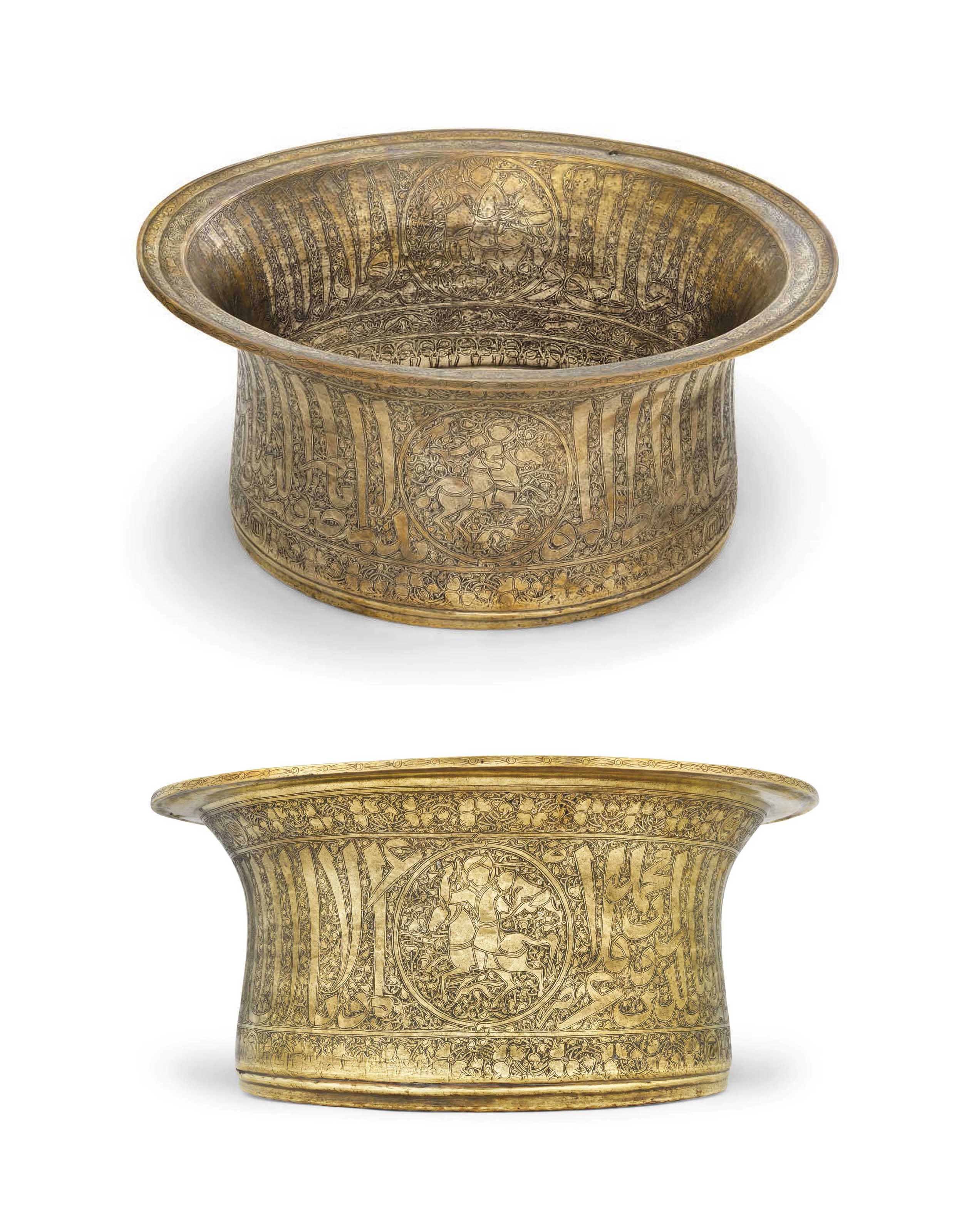 A GOLD AND SILVER-INLAID BRASS