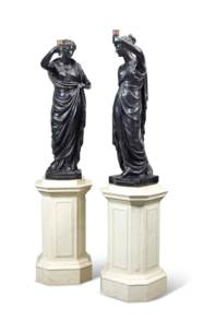 A PAIR OF PATINATED PLASTER FI