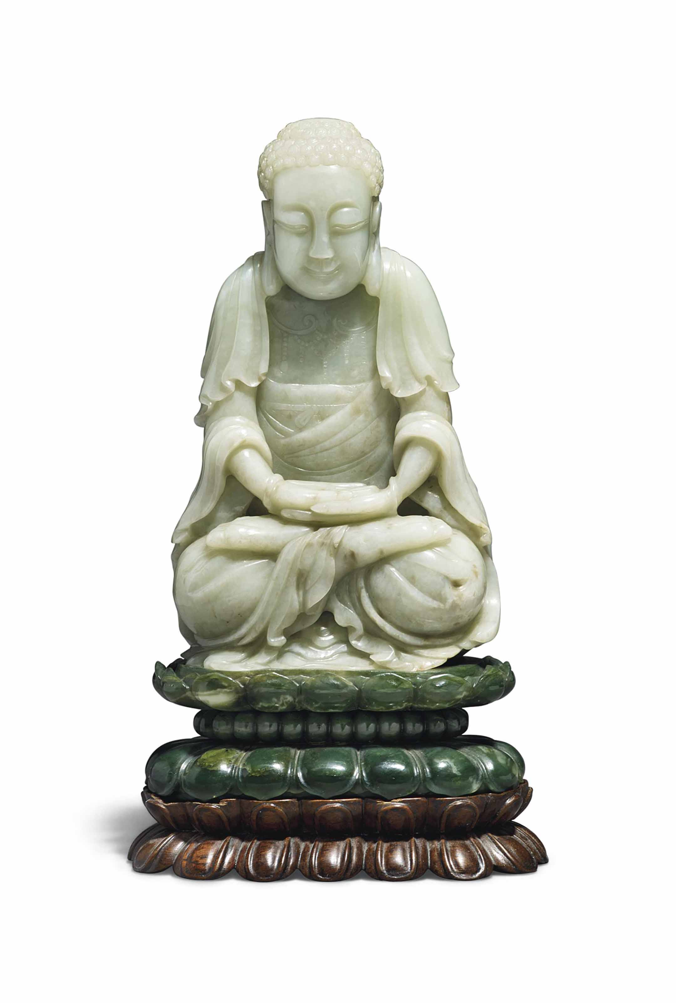 A RARE PALE CELADON JADE FIGURE OF A SEATED BUDDHA