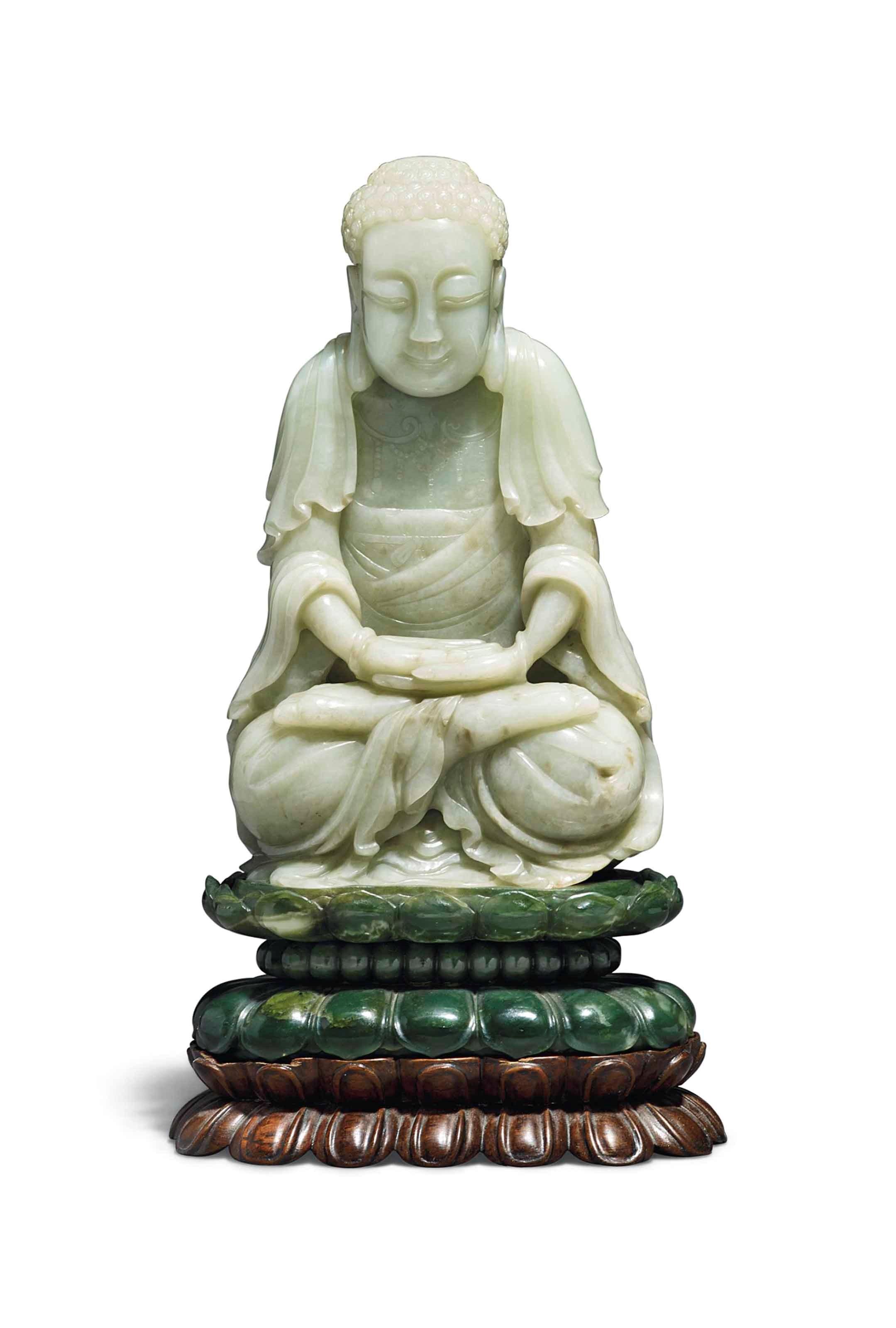 清十八十九世纪 青白玉佛像连碧玉座,高9¼吋 (23.5公分),此拍品于2016年11月8日在佳士得伦敦中国瓷器及工艺精品拍卖中以110,000英镑成交。