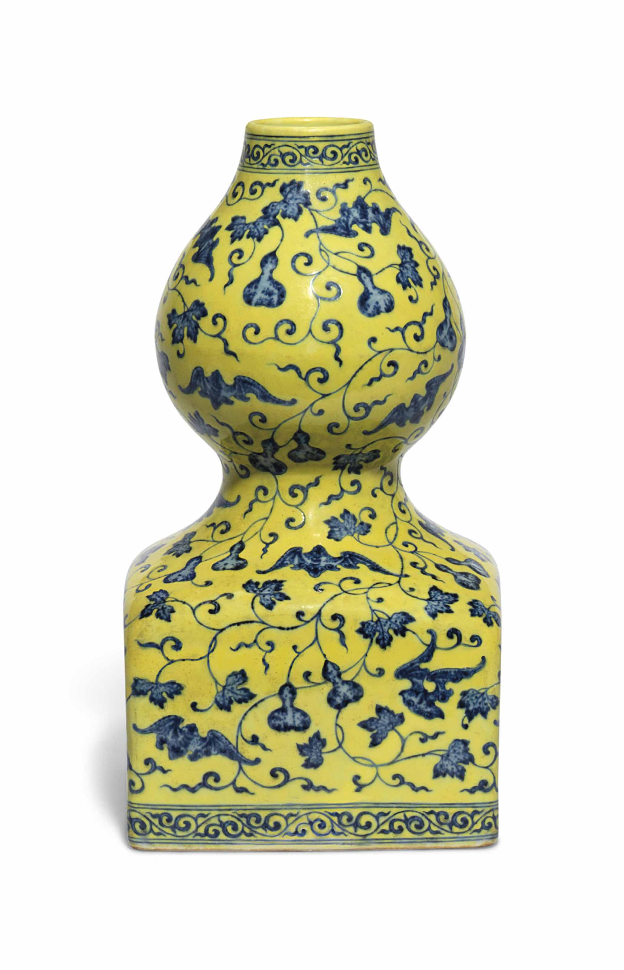 AN UNDERGLAZE-BLUE AND YELLOW ENAMELLED DOUBLE GOURD VASE