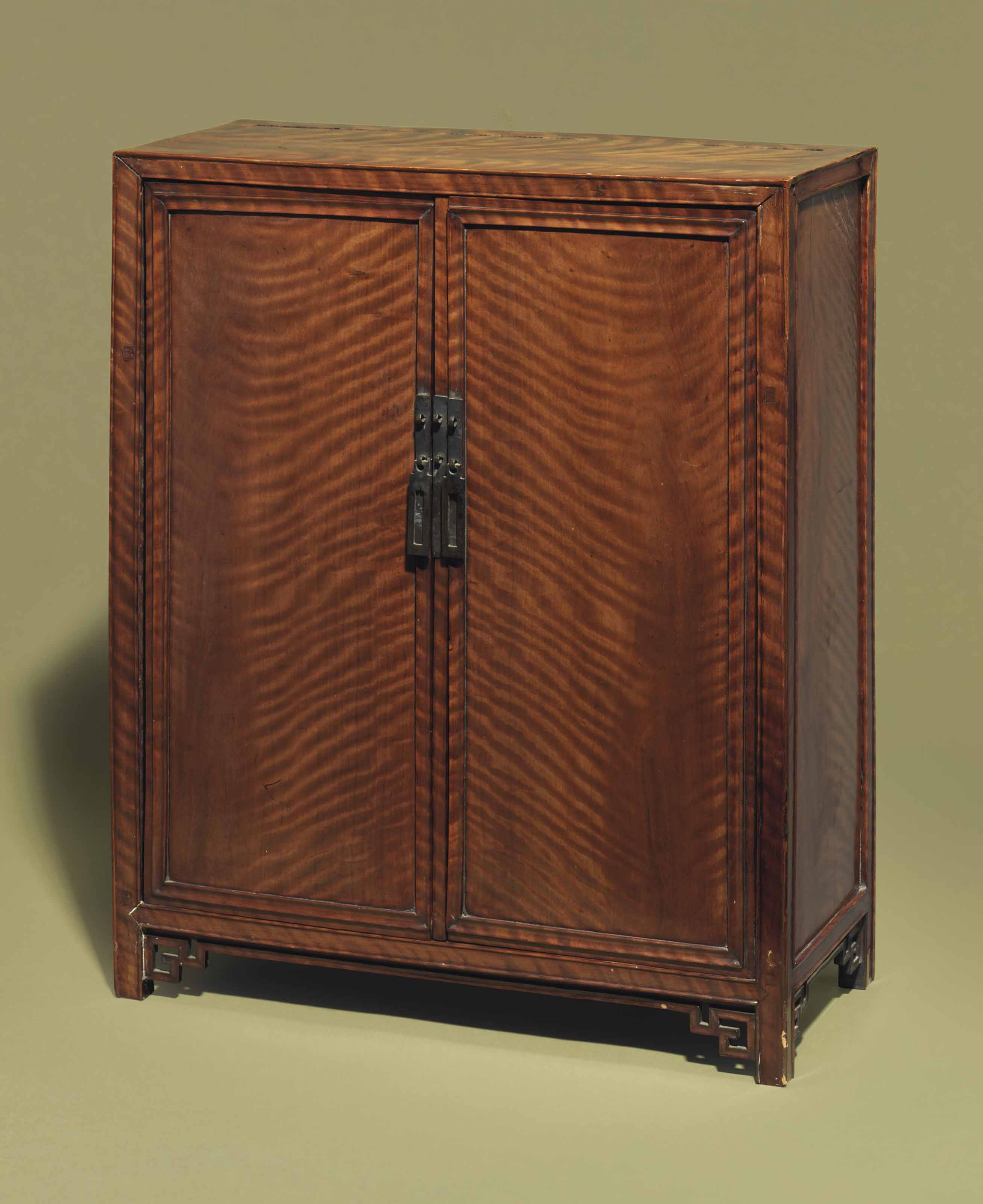 A TIGER-MAPLE TABLE CABINET