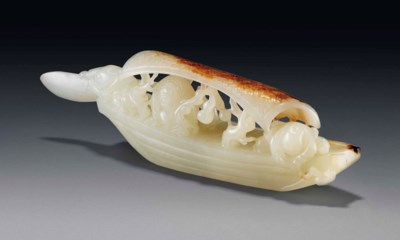 A WHITE JADE AND RUSSET CARVIN