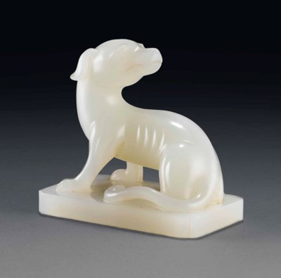 A WHITE JADE MODEL OF A DOG