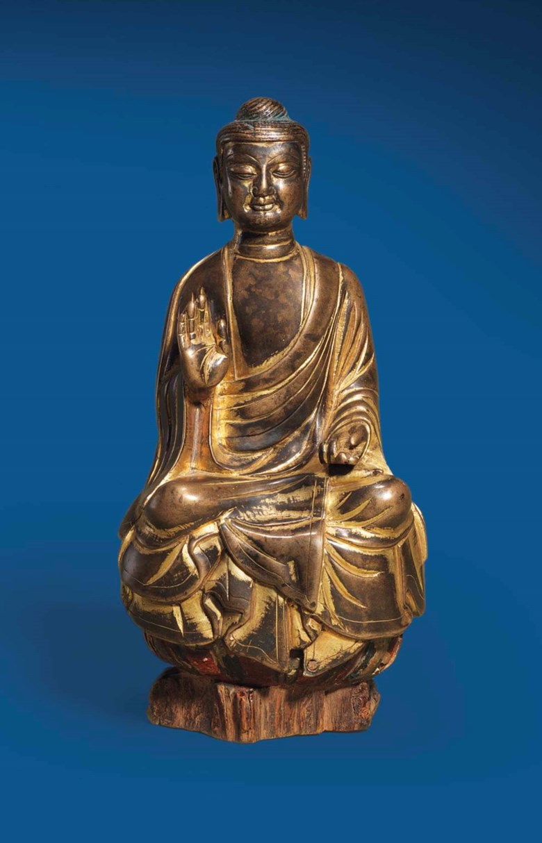 A rare and finely cast gilt-bronze figure of Sakyamuni. Sui dynasty (581-618). 6⅞ in (17.5 cm) high including wood base. This lot was offered in Chinese Ceramics & Works of Art  on 8 November 2016 at Christie's in London and sold for £112,500