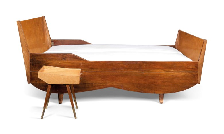 Carlo de Carli (1910-1999), A unique bed, 1949. Stained walnut, laminated birch. 39 in (99 cm) high; 70 in (178 cm) wide; 80⅛ in (203.5 cm) deep. Estimate £2,000-4,000. This lot is offered in Design on 26 October 2016 at Christie's in London, King Street