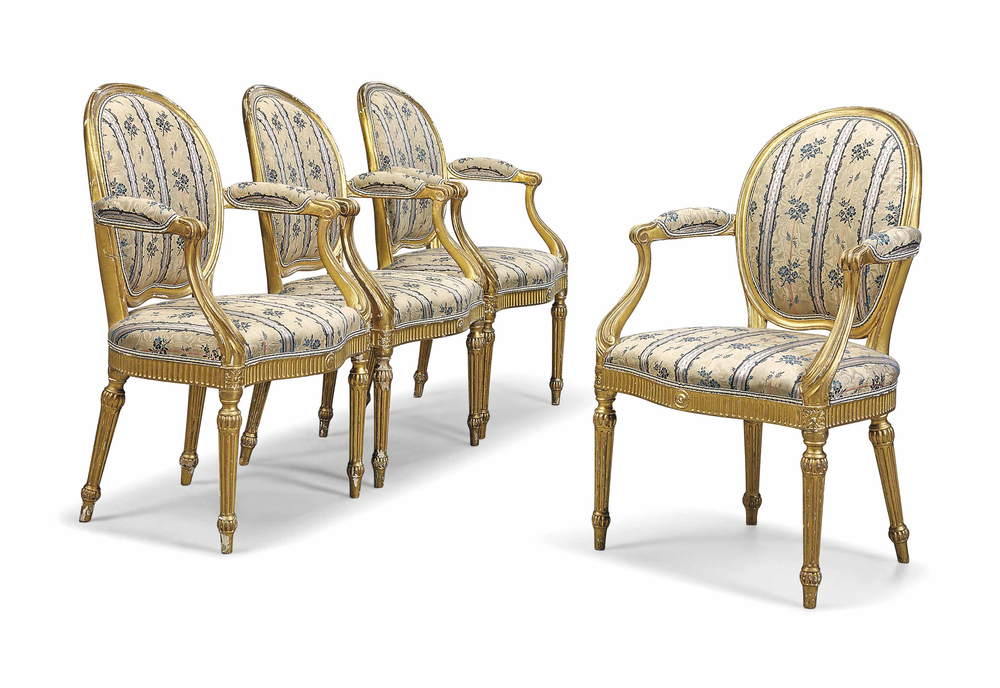 A SET OF FOUR GEORGE III GILTWOOD OPEN ARMCHAIRS