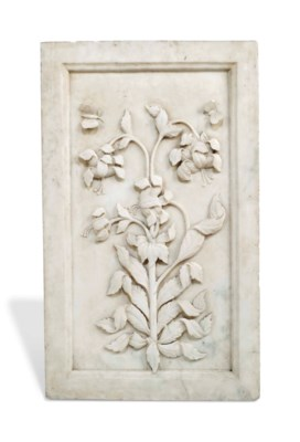 A FINELY CARVED MUGHAL WHITE M