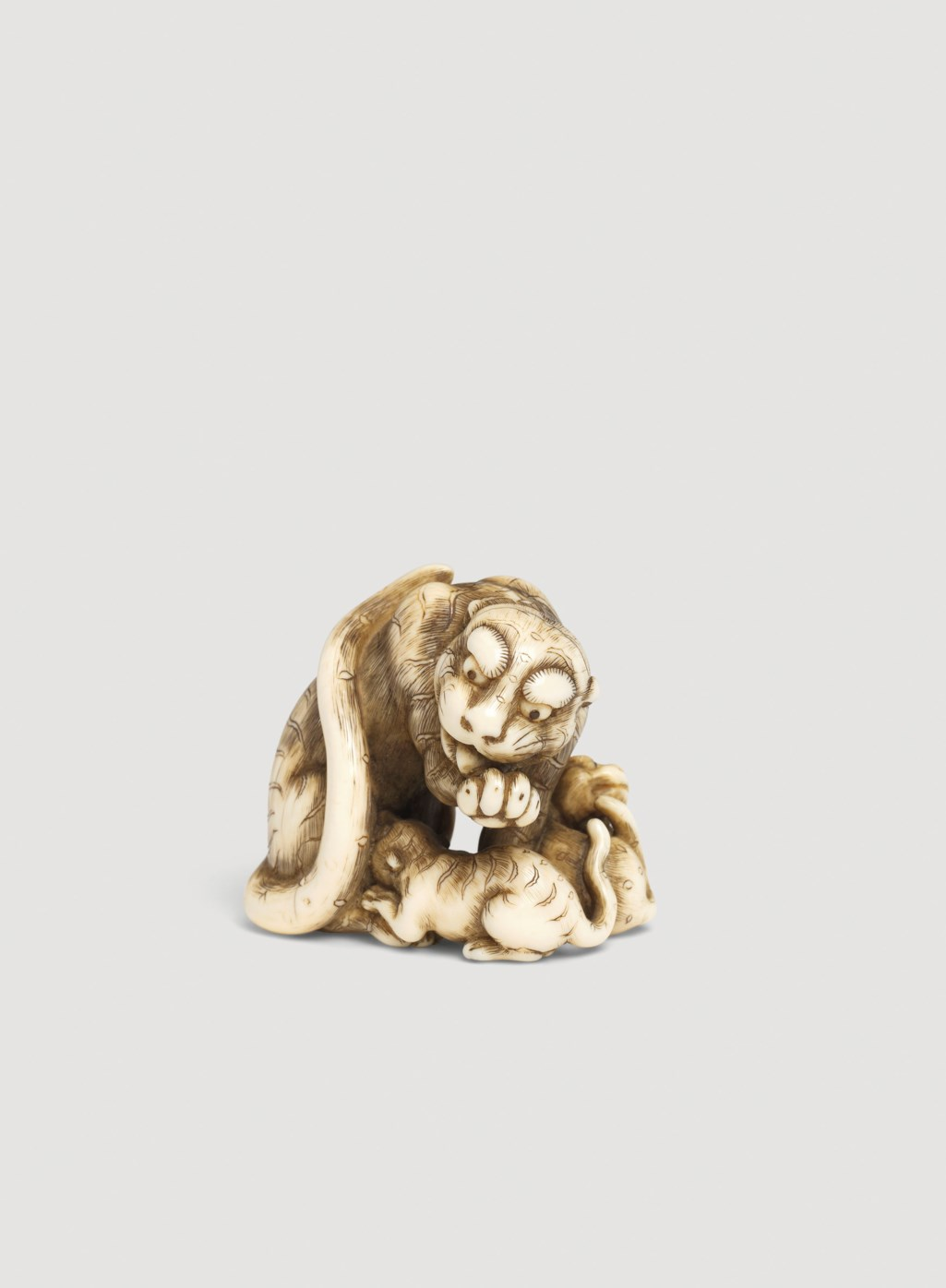 58aa5a82d30f A Rare Ivory Netsuke of a Tiger and Two Cubs