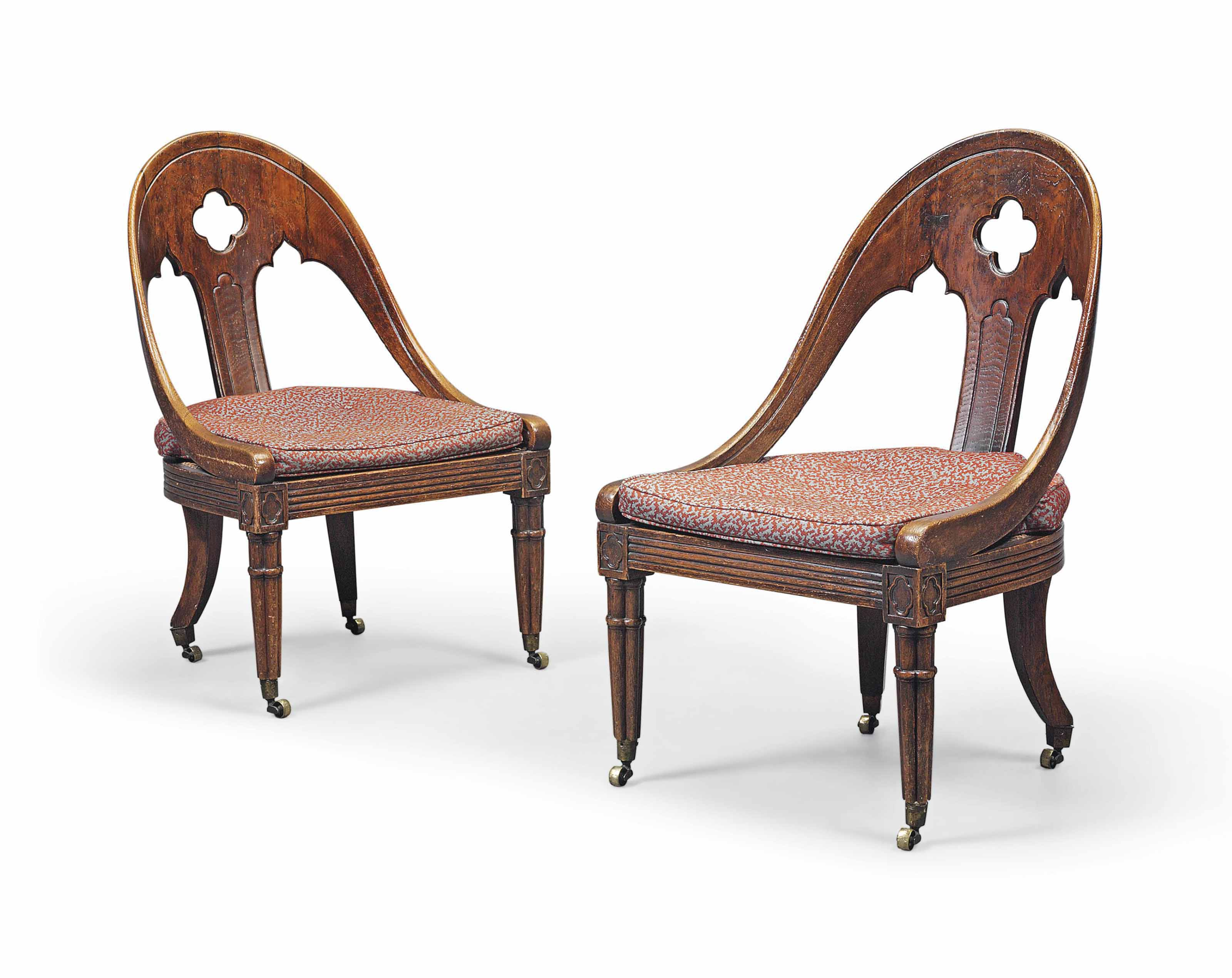 A PAIR OF REGENCY GOTHIC CANED OAK CHAIRS