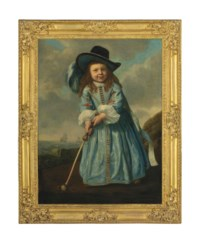 Portrait of a boy playing golf by the shore