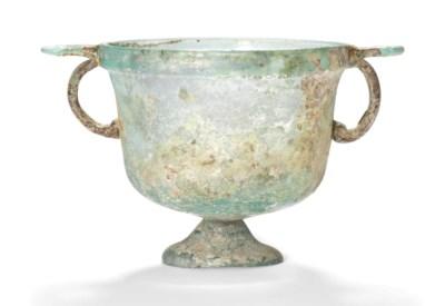 A ROMAN GREEN GLASS SKYPHOS