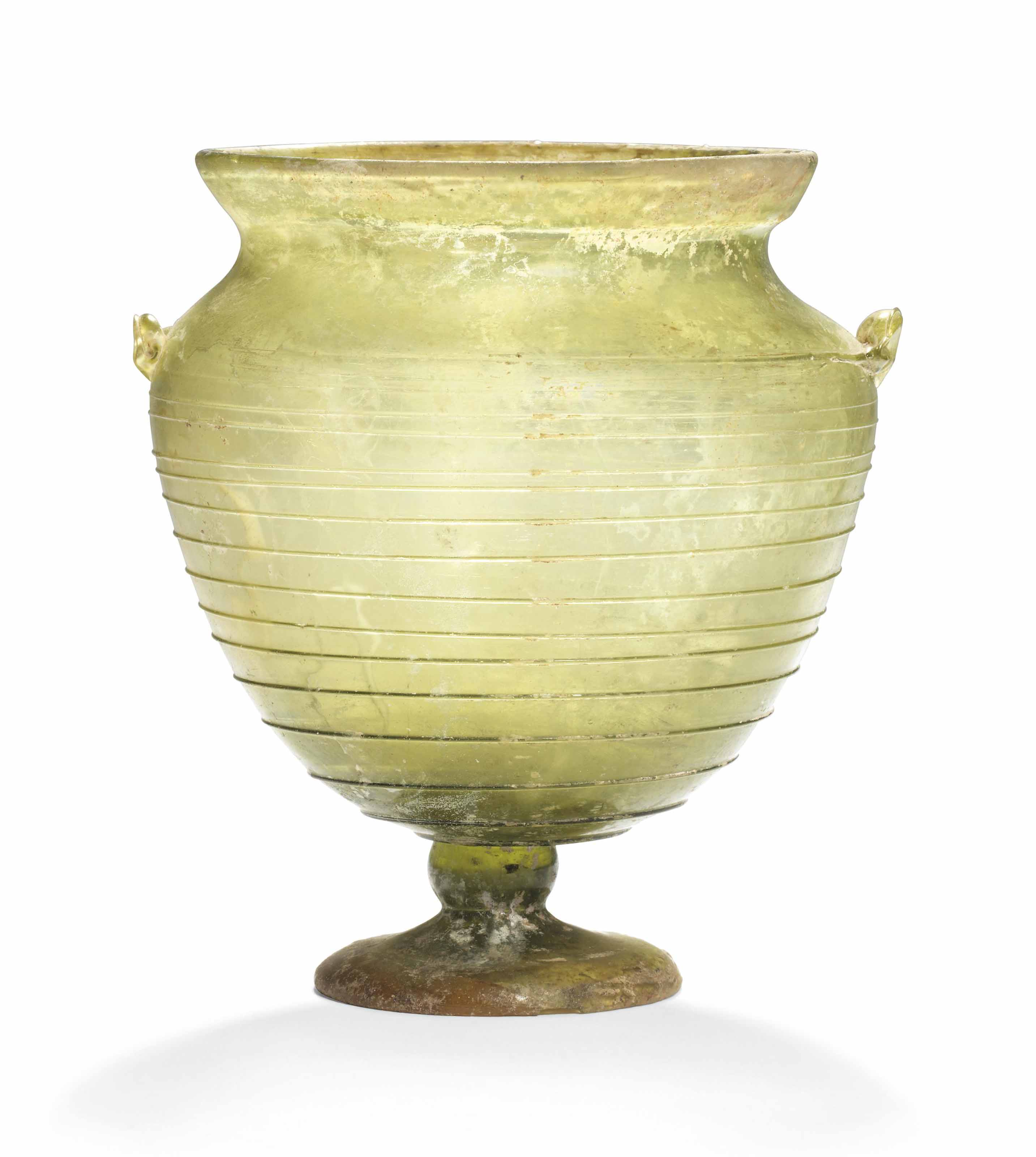 A ROMAN GREEN GLASS FOOTED KAN