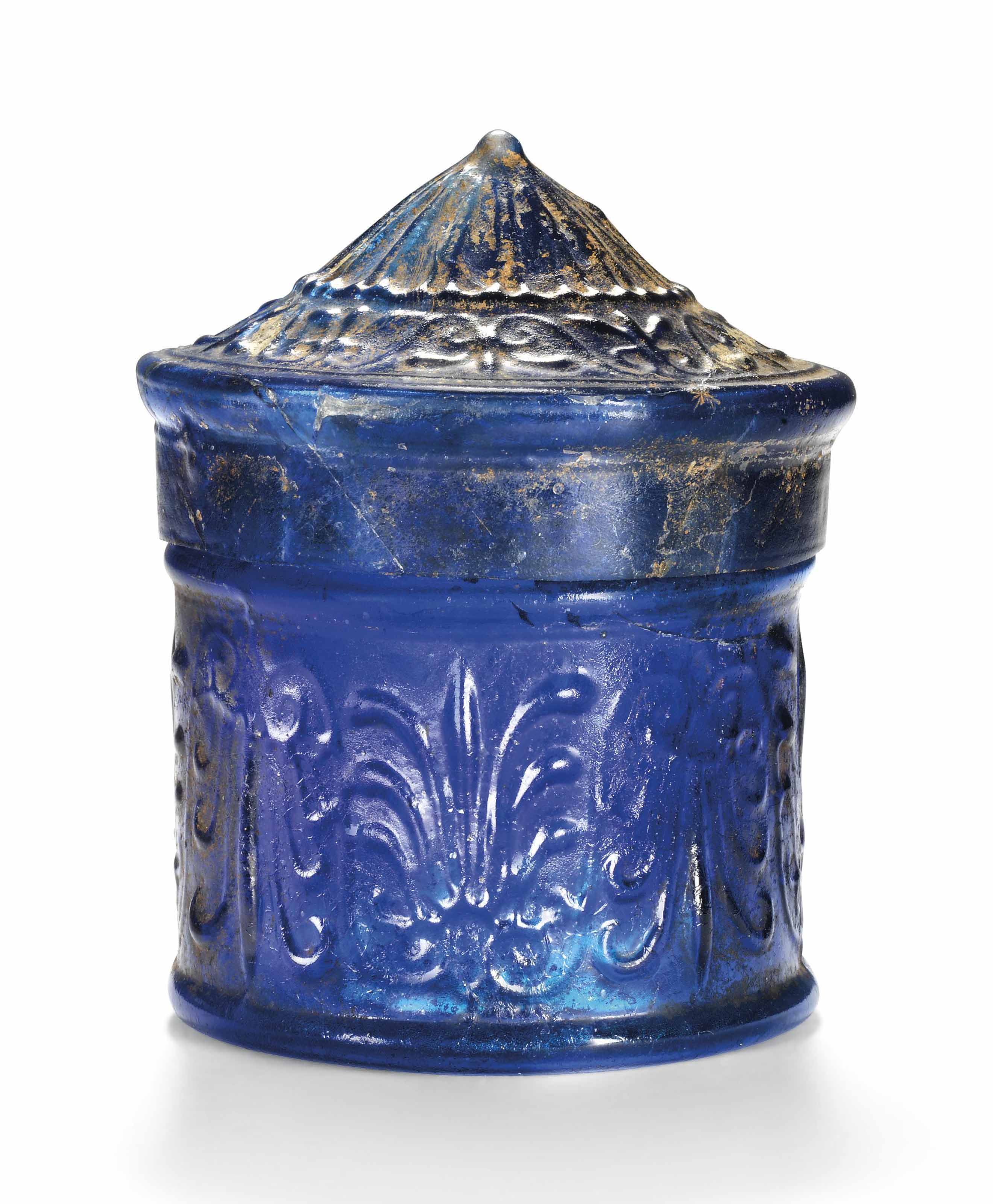 A ROMAN COBALT BLUE GLASS PYXIS WITH CONICAL LID