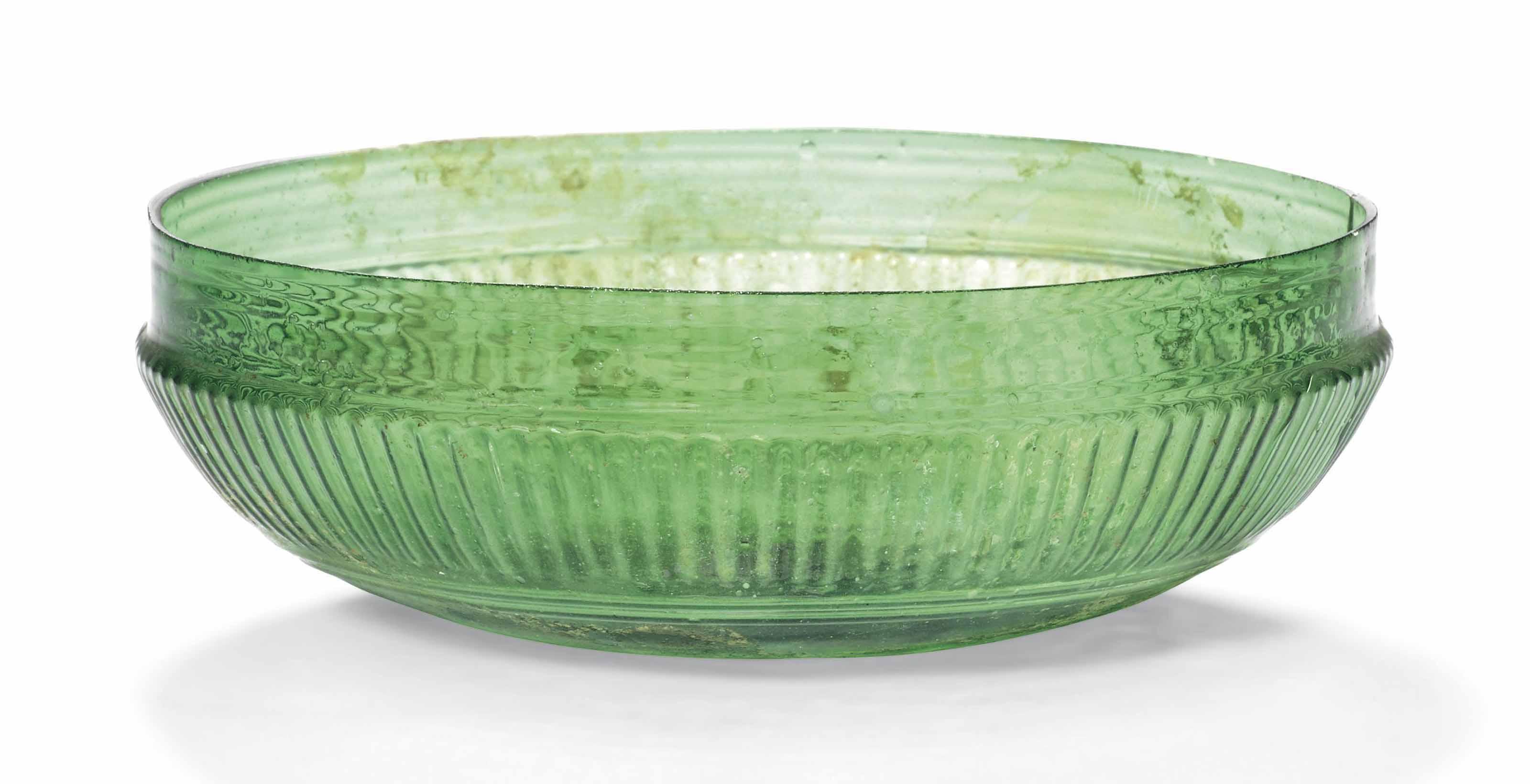 A ROMAN EMERALD GREEN GLASS RI