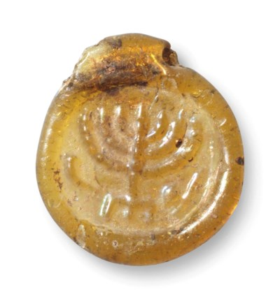 AN EARLY JEWISH AMBER GLASS PE
