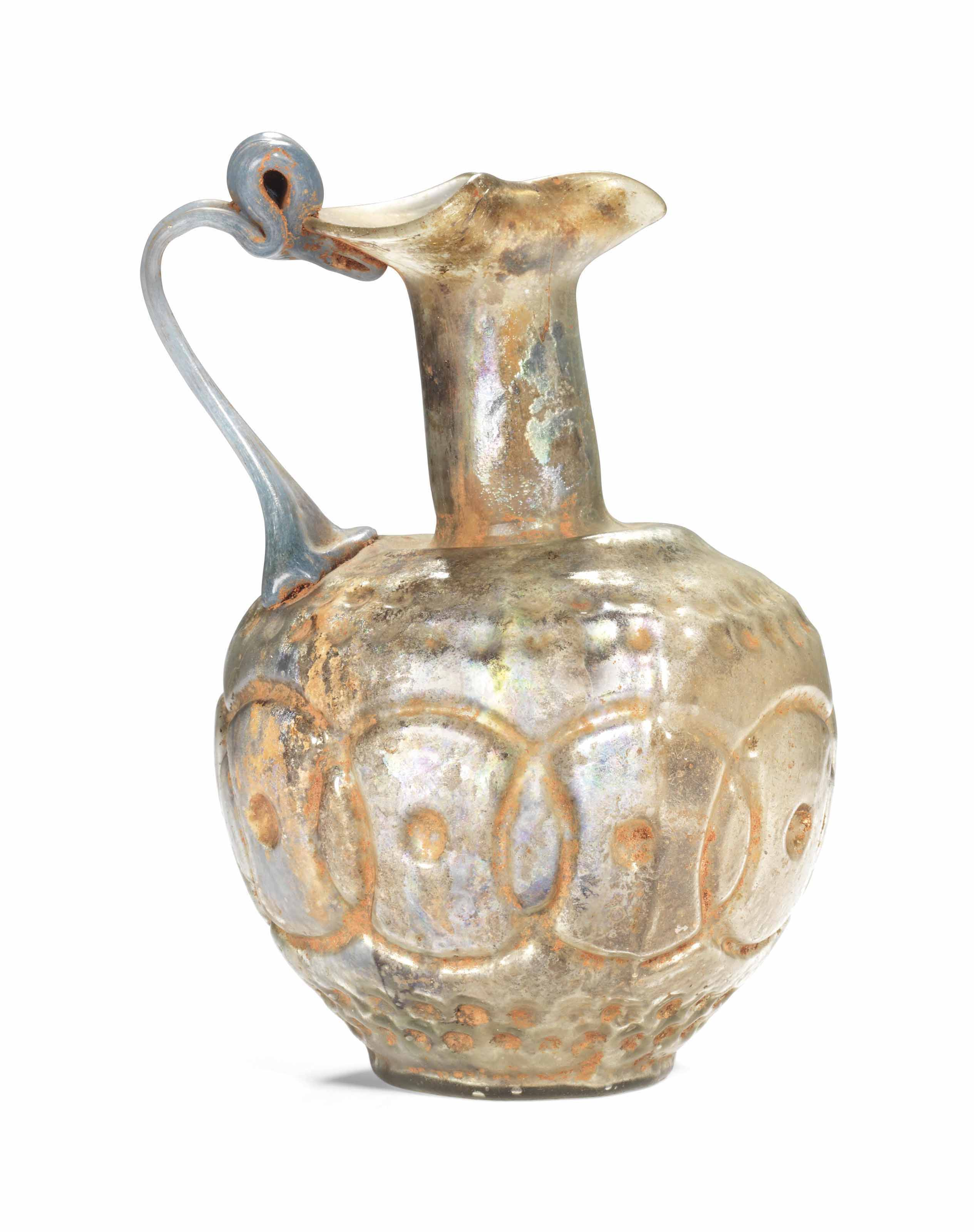 A ROMAN COLOURLESS GLASS TREFO