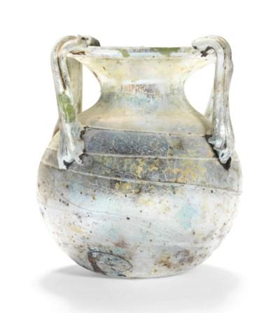 A ROMAN GREEN GLASS MULTI-HAND