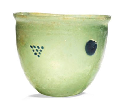 A LATE ROMAN YELLOW-GREEN GLAS