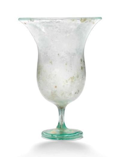 AN EARLY BYZANTINE GREEN GLASS
