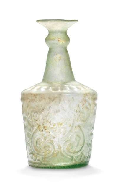 AN ISLAMIC PALE GREEN GLASS BO