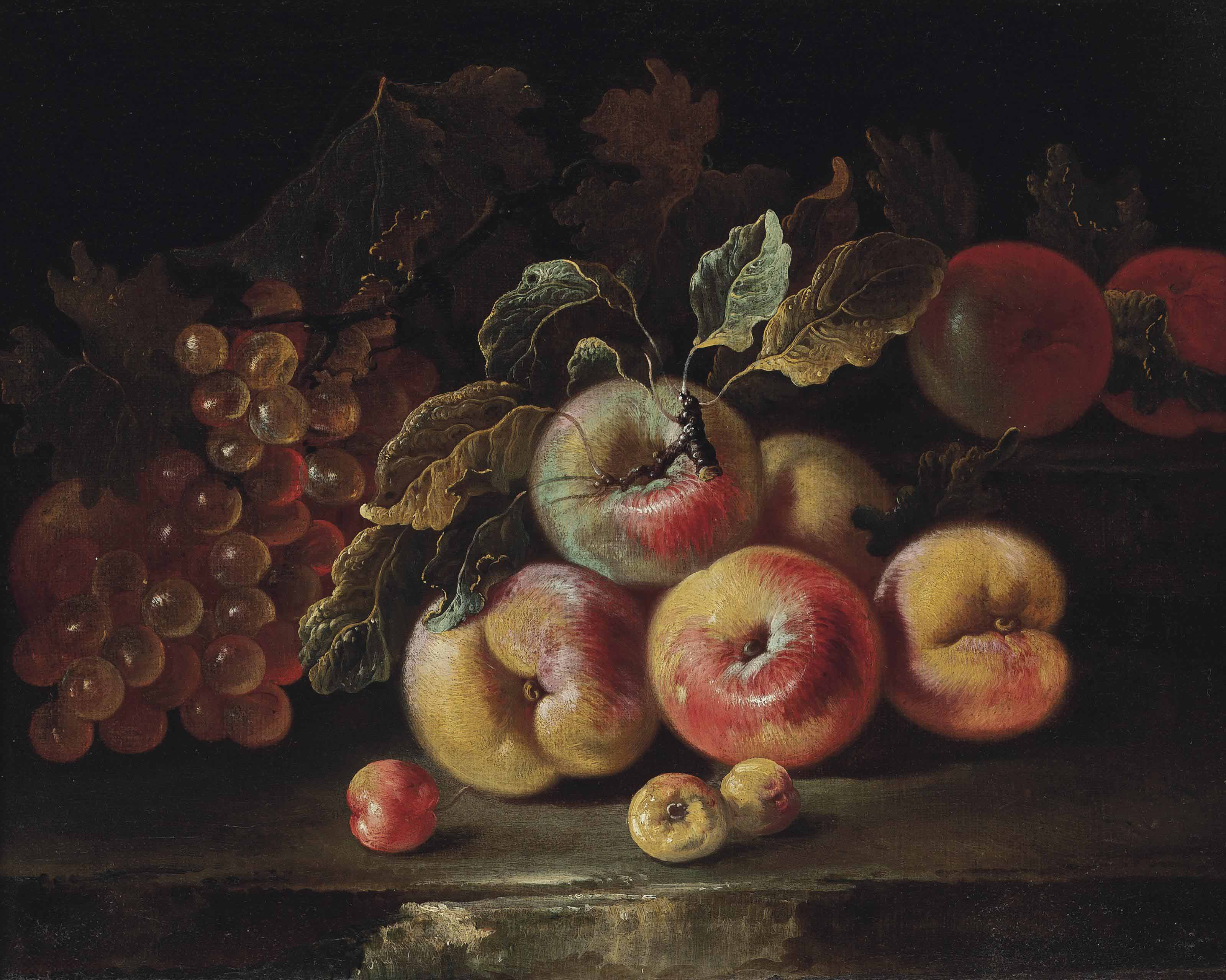 Peaches, grapes and plums on a stone ledge