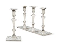 A SET OF FOUR GEORGE III IRISH SILVER CAST CANDLESTICKS