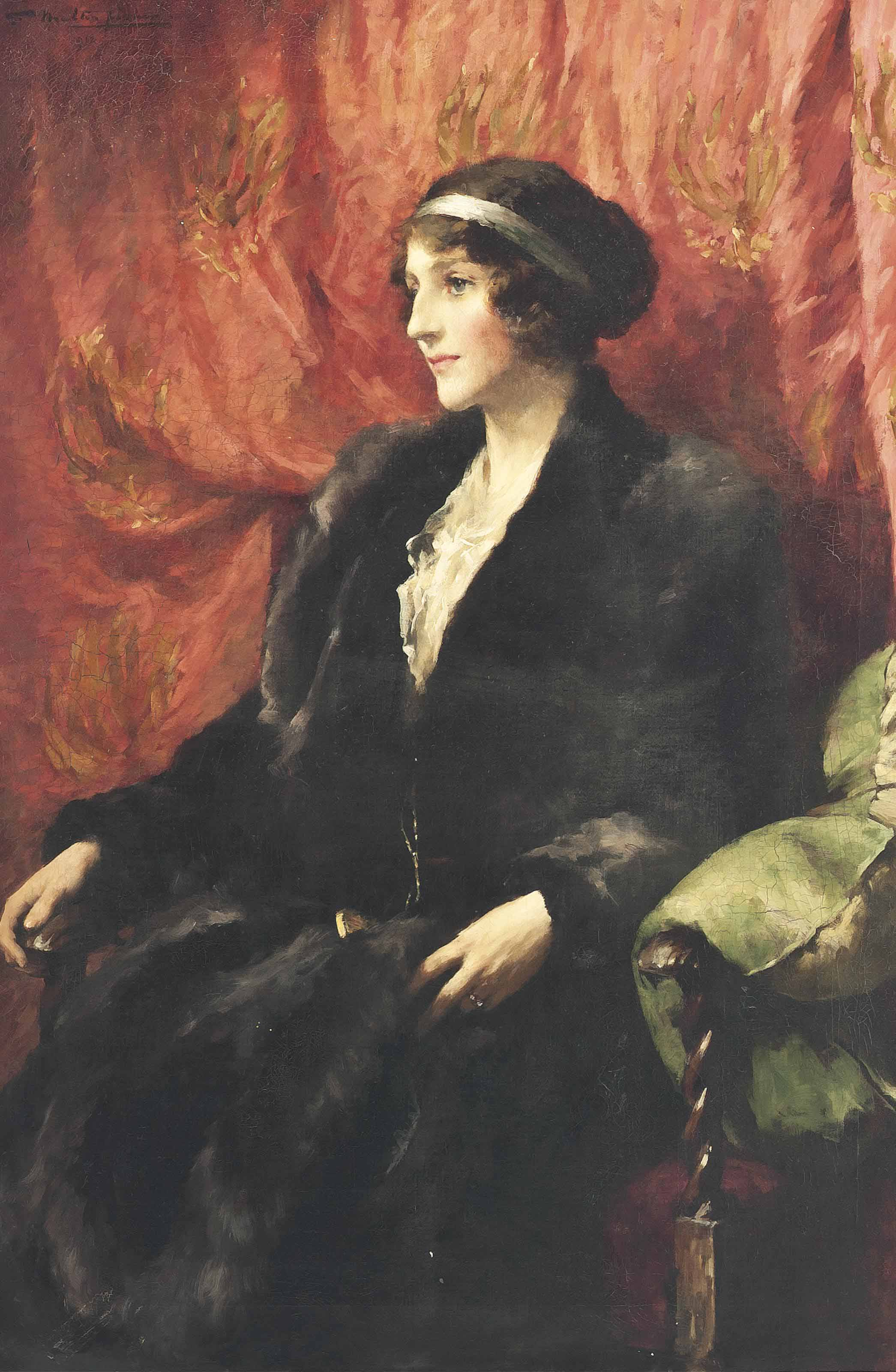 Portrait of a lady, three-quarter length, seated wearing a fur coat and a hair band